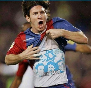 Lionel Messi with kidnapped kids shirt